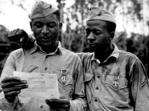 Ст. сержант Timerlate Kirven и капрал Samuel J. Love первые афро-американские морские пехотинцы получившие Пурпурное сердце. Представлены к награде за ранения, полученные в период битвы за Сайпан в 1944 году.