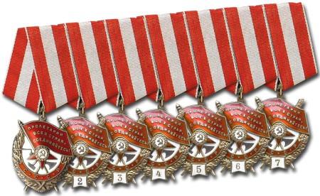 """Орден Красного Знамени повторного награждения. На белом эмалевом щитке расположены цифры """"2"""", """"3"""", """"4"""" и так далее, обозначающие количество награждений."""